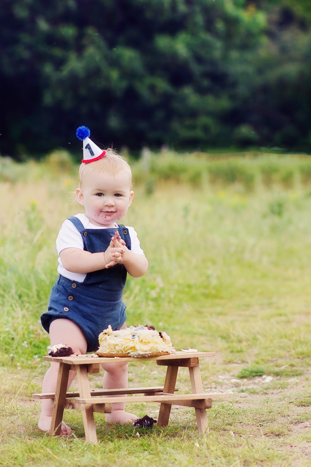 Baby Hero in Elfie Dungarees and Little Blue Olive Hat Cake smash