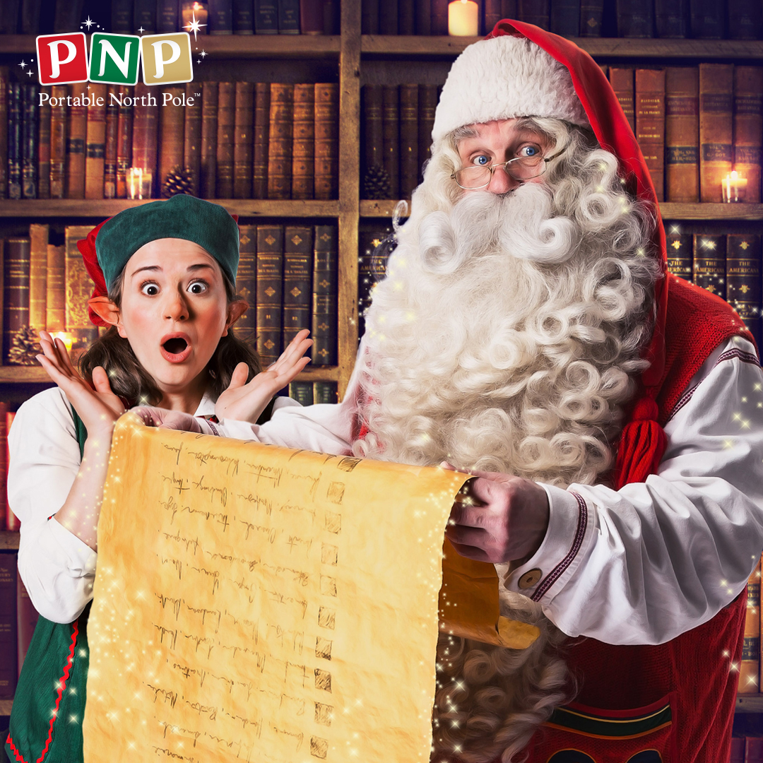 father christmas checking his list at the portable north pole
