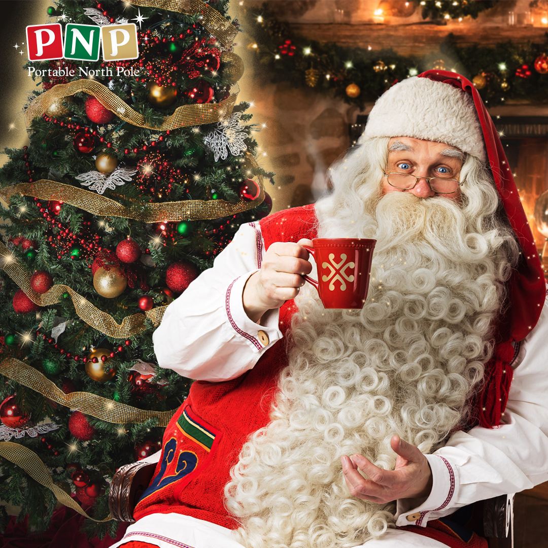 FATHER CHRISTMAS AT THE PORTABLE NORTH POLE ENJOYING HOT CHOCOLATE