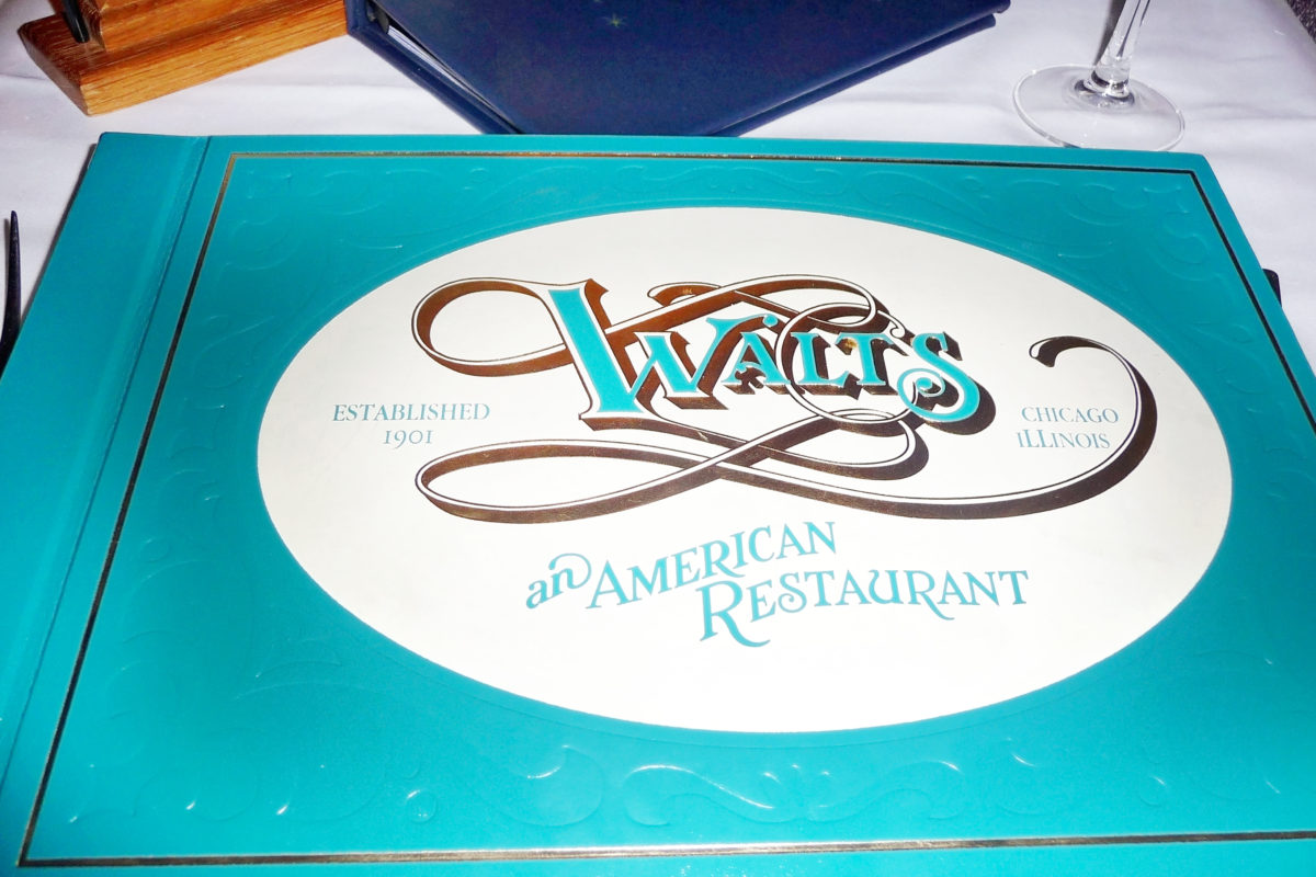 Image shows the front cover of the menu of Walt's, and American restaurant, in Disneyland paris.