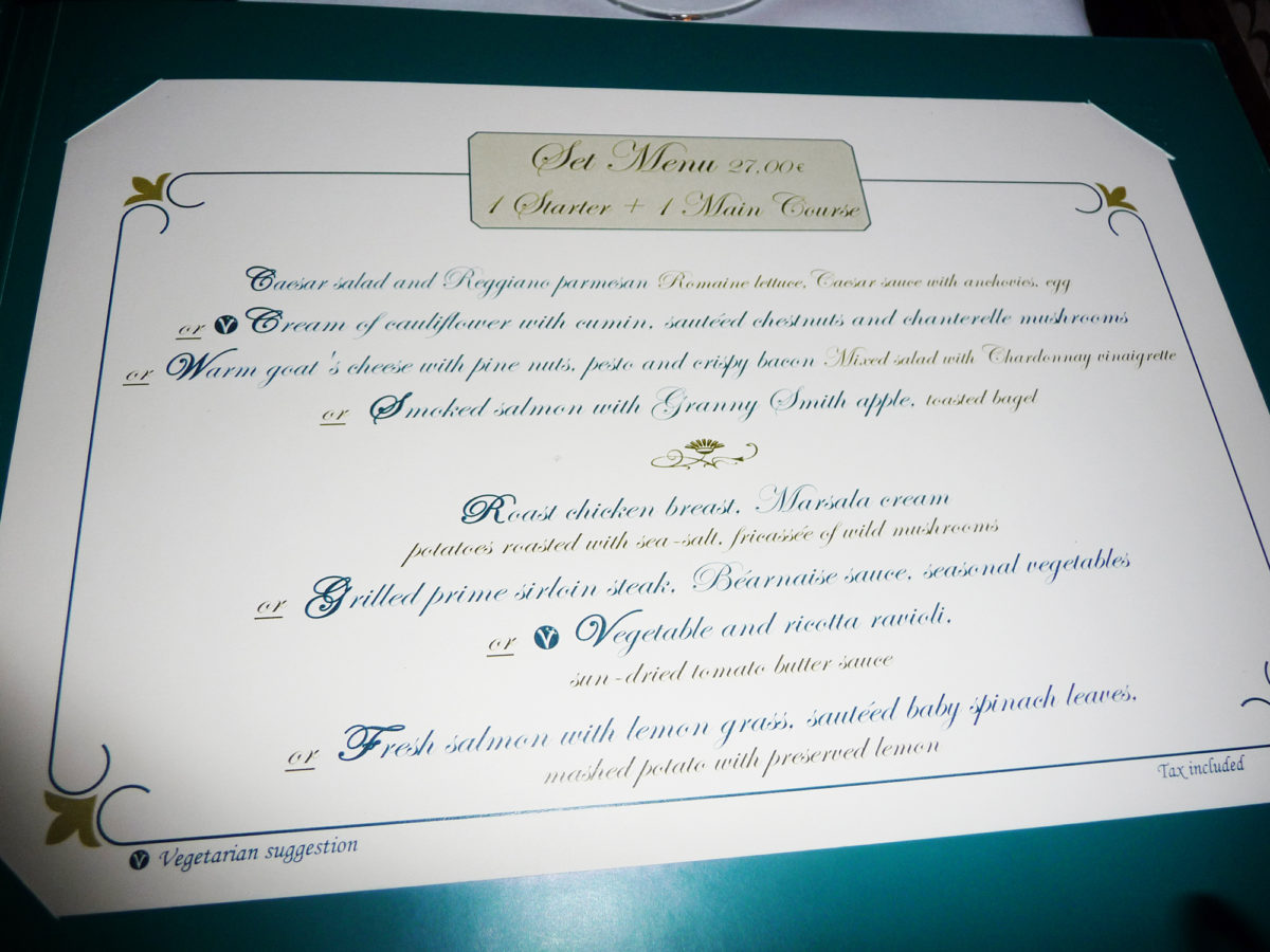 Image shows the inside of the menu at walt's restaurant in disneyland paris. The prices and items are listed.