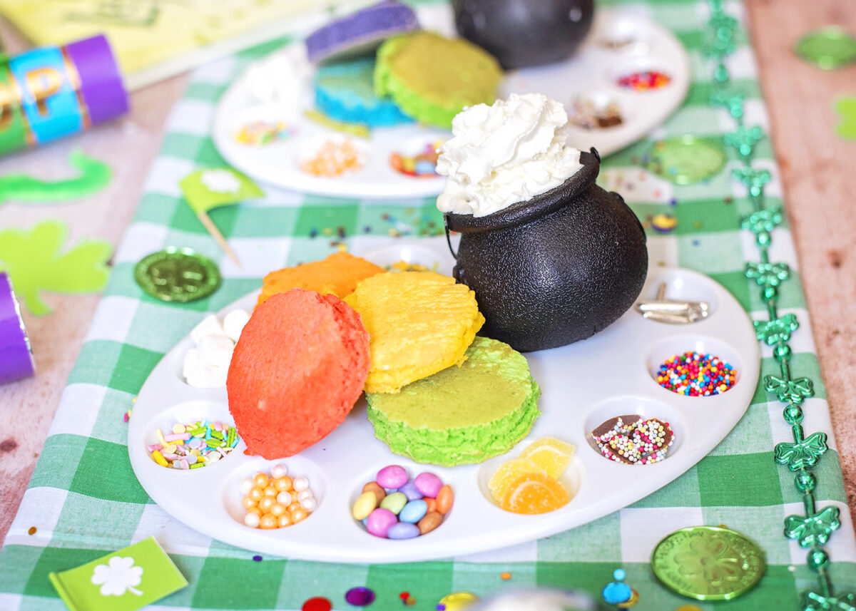 Decorate your own pancake party, with mini rainbow pancakes, sprinkles and cream. Checkered green and white tablecloth fabric for St. Patrick's Day