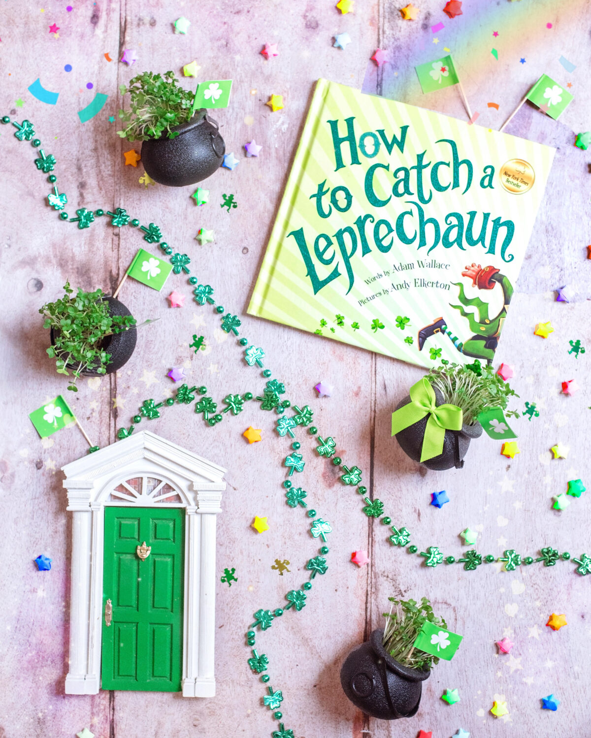 Image shows St. Patrick's Day Leprechaun door, rainbow lucky stars, shamrock in little black cauldon pots of gold, green metallic shamrock necklaces and a  How to Catch a Leprechaun Book. Easy, last minute crafts for celebrating St. Patrick's day with kids complete with supply list.