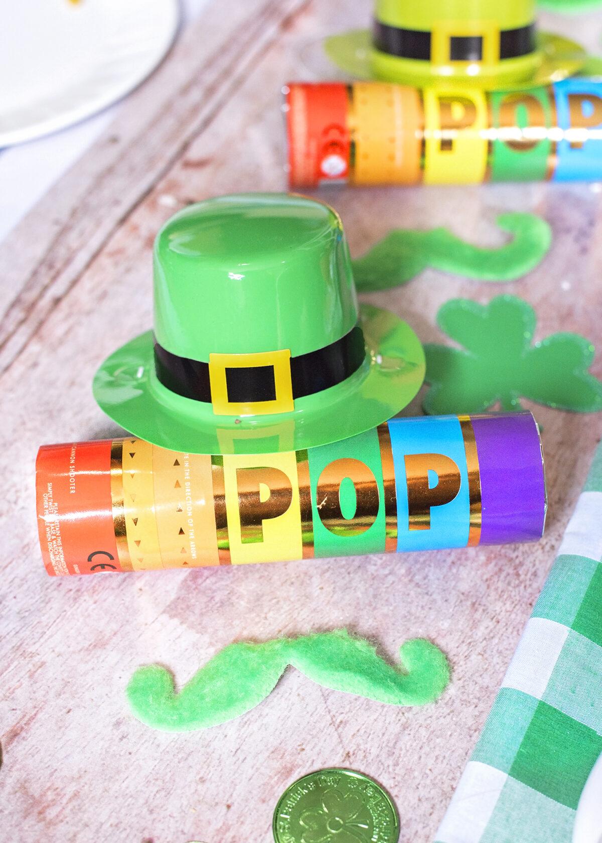Leprechaun Party Favours. Mini Leprechaun hat, Green Stick on moustache and rainbow confetti party popper cannon.