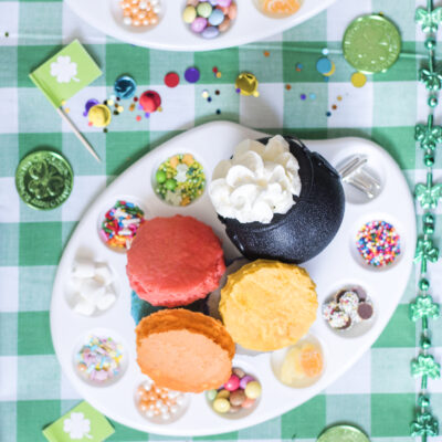 Decorate your own pancakes party - rainbow sprinkles on an artist's palette, shamrock flags and Leprechaun green golden coins