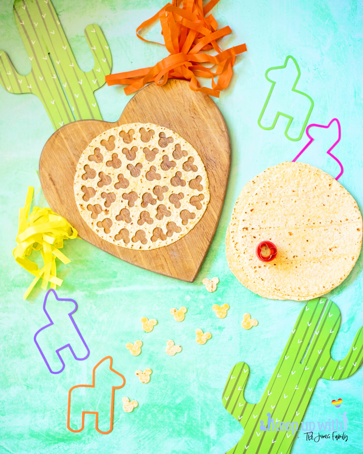 Image shows how to cut nacho chips from a tortilla. There are colourful llama cut outs and cardboard cacti, and a tortilla wrap which has been cut into little Mickey Mouse shaped pieces.  Keep up with the jones family