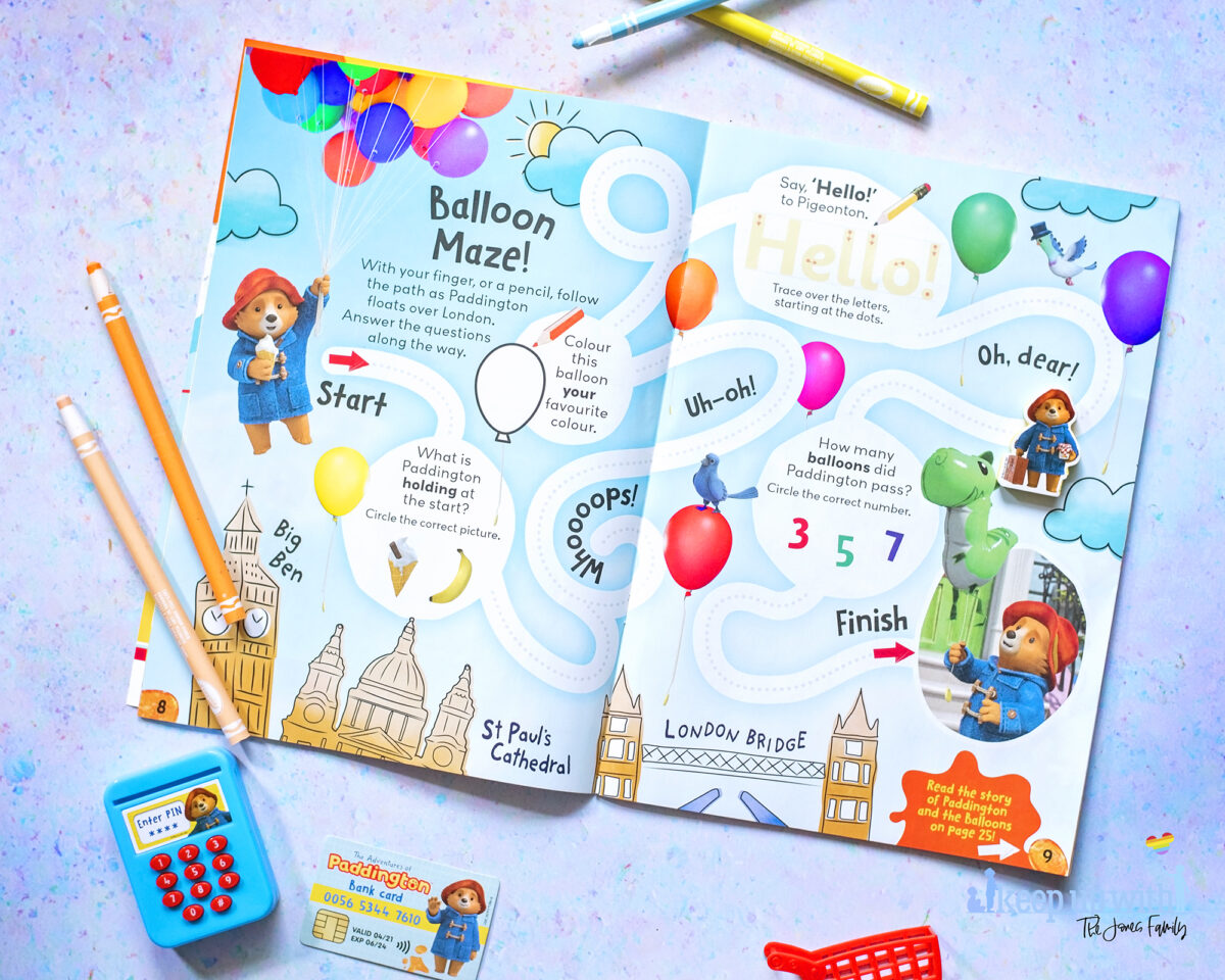 The Adventures of Paddington Bear Magazine EYFS. Photograph shows a two page spread featuring a balloon maze with paddington and his free shopping gift which comes with issue one.  Fun learning for children and early years foundation stage goals.