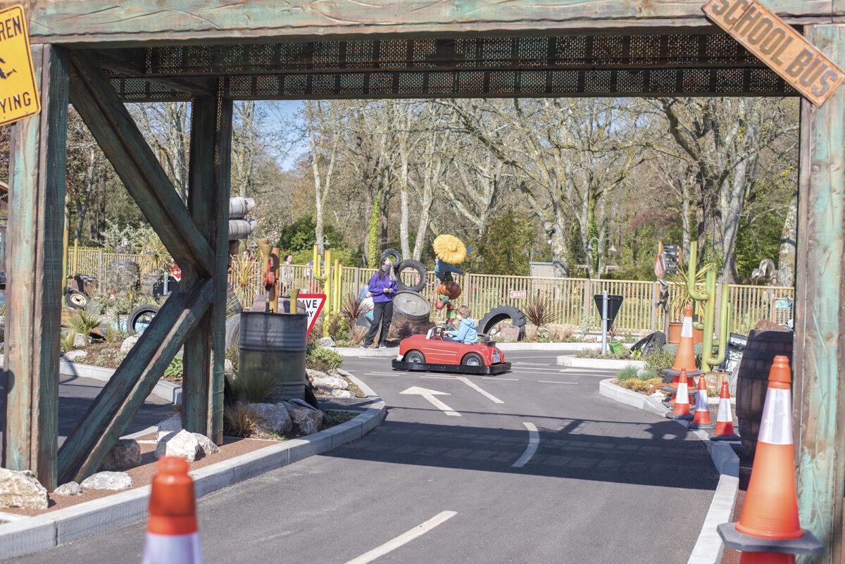 Image shows the track at al's auto academy attraction at Tornado Springs in Paultons Park.
