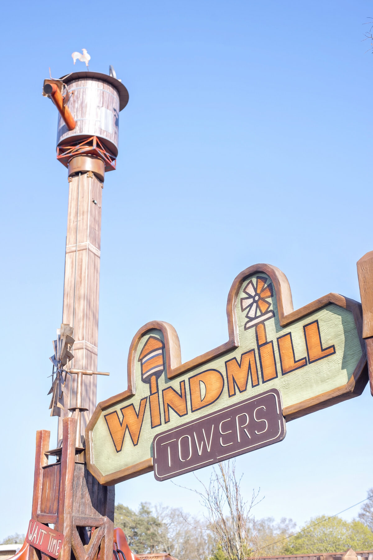 Image shows the signage for the Windmill Falls ride at Tornado Springs, Paultons Park, Hampshire.