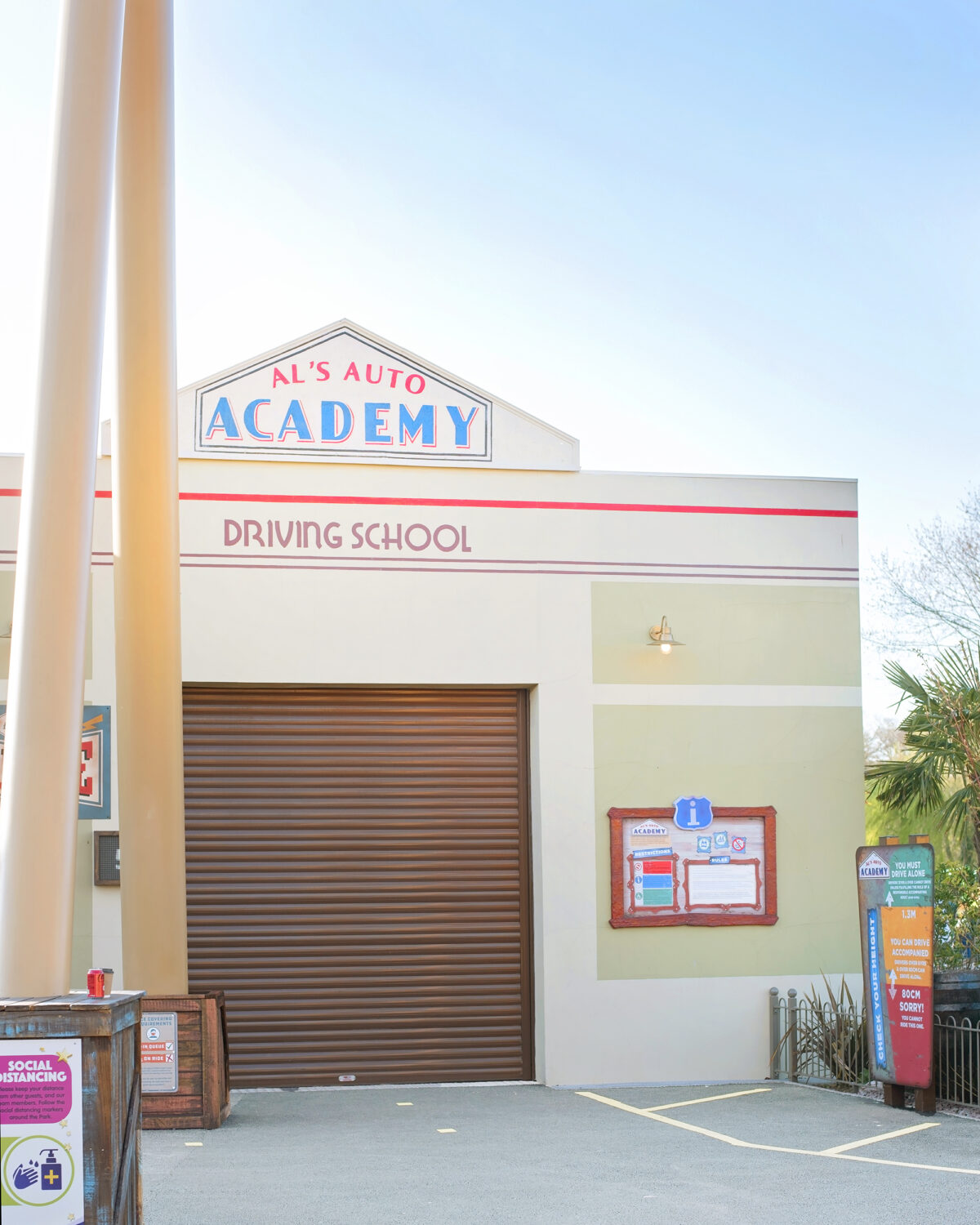 Image shows the building for Al's Auto Academy Driving School at Tornado Springs in Paultons Park.