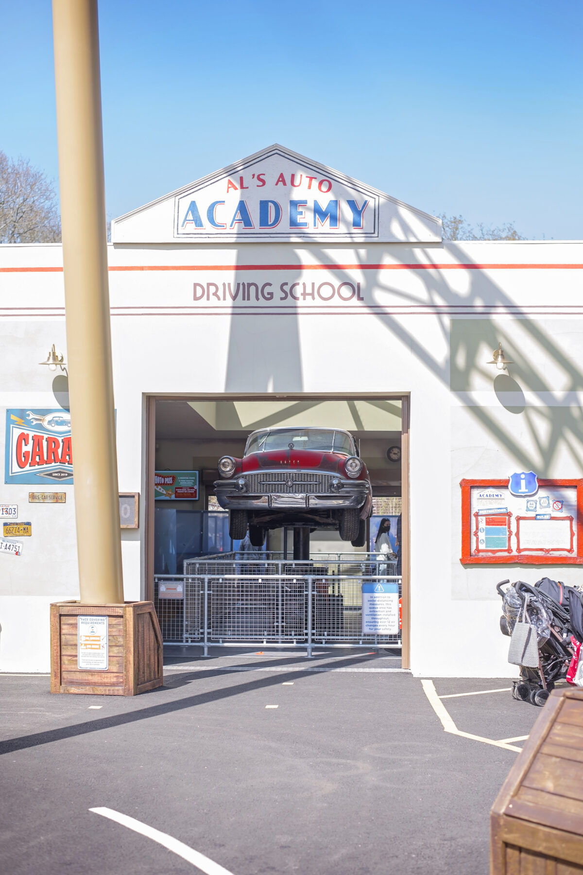 Image shows the open queue area and elevated 1950s car at  Al's Auto Academy Driving School at Tornado Springs in Paultons Park.