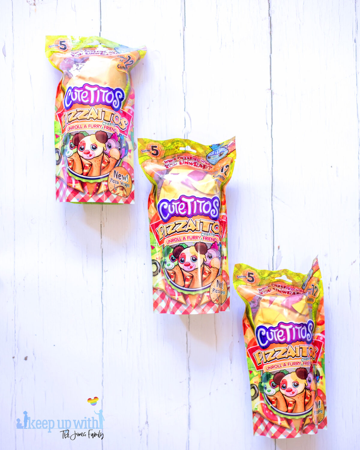 Cuteitos Pizzaitos. Image shows three Cuteitos Pizzaitos in their wrappers on a white wooden background.