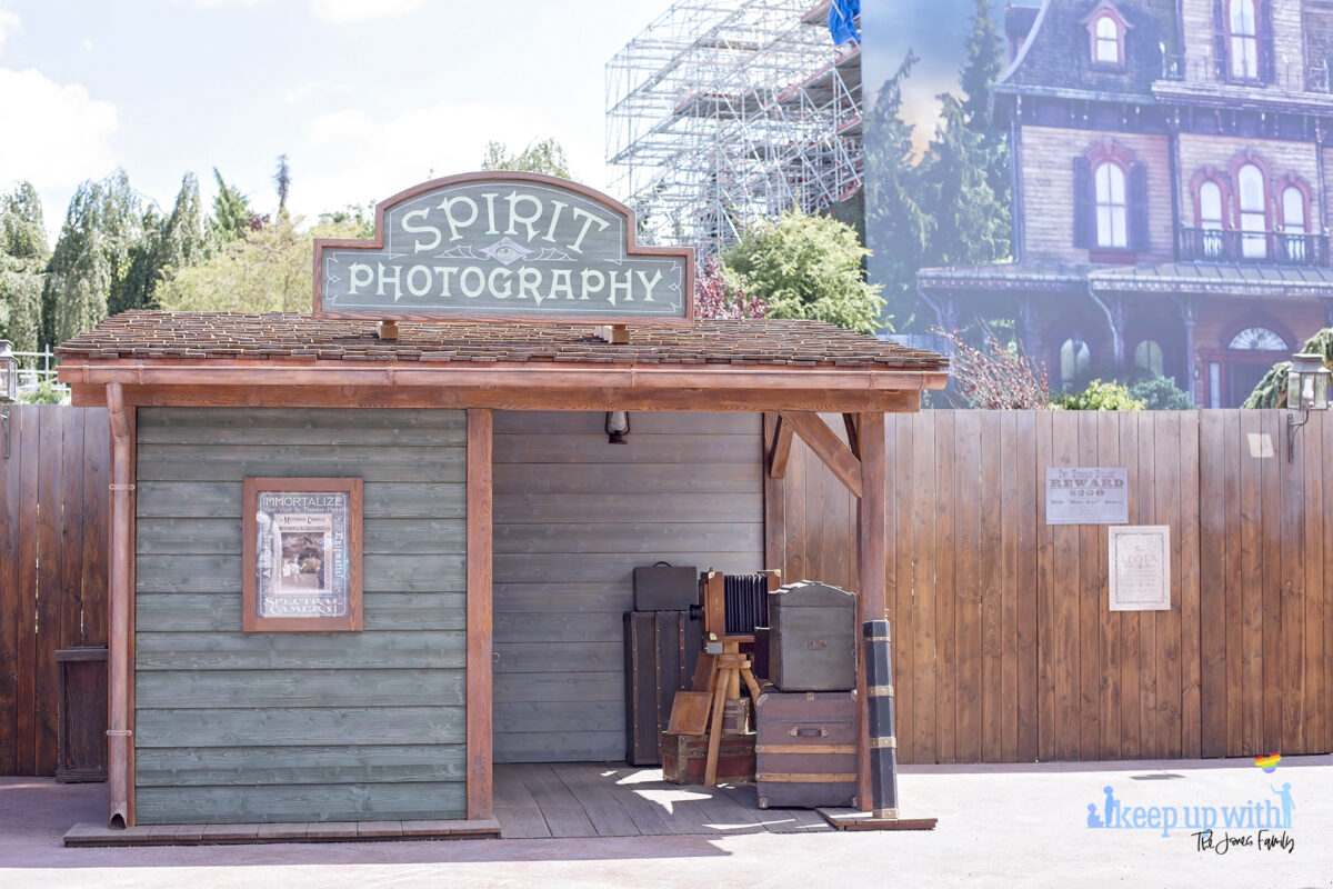 Image shows the Disneyland Paris Spirit Photography Booth where you can print a personalised copy of the Mysterious Chronicle by Phantom Manor. Image by Keep Up With The Jones Family.