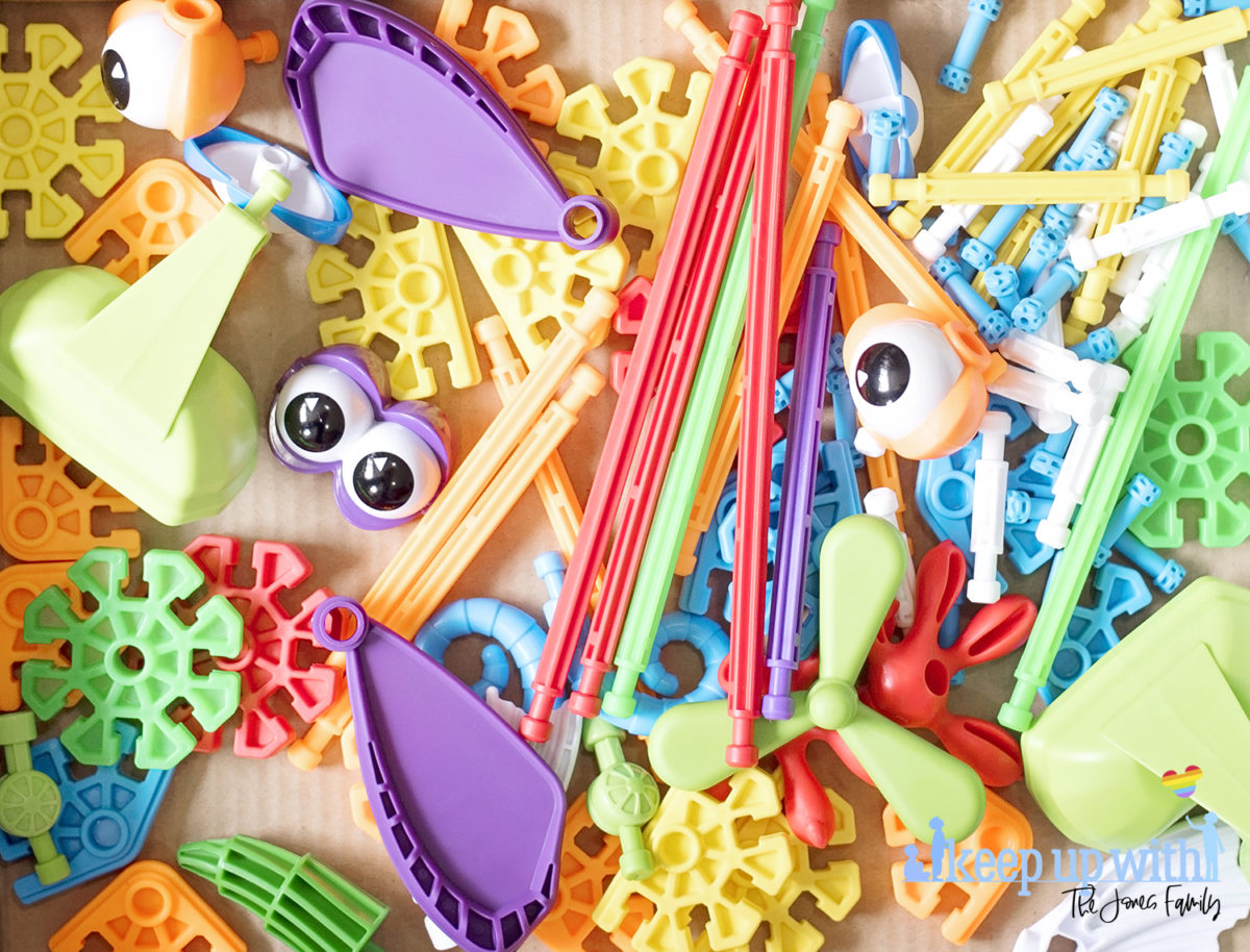 Image shows flatlay of the colourful pieces inside the Kid K'nex Budding Builders construction toys box from Basic Fun UK.  By Keep Up With The Jones Family
