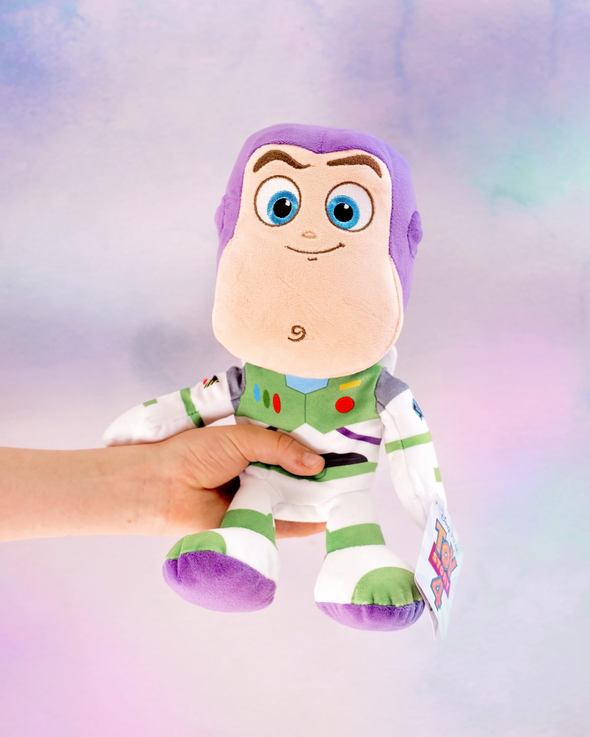 Image shows profile view of Disney Pixar's Toy Story Character Buzz Lightyear as a plush toy from SImba Toys. Image by Keep Up With The Jones Family.