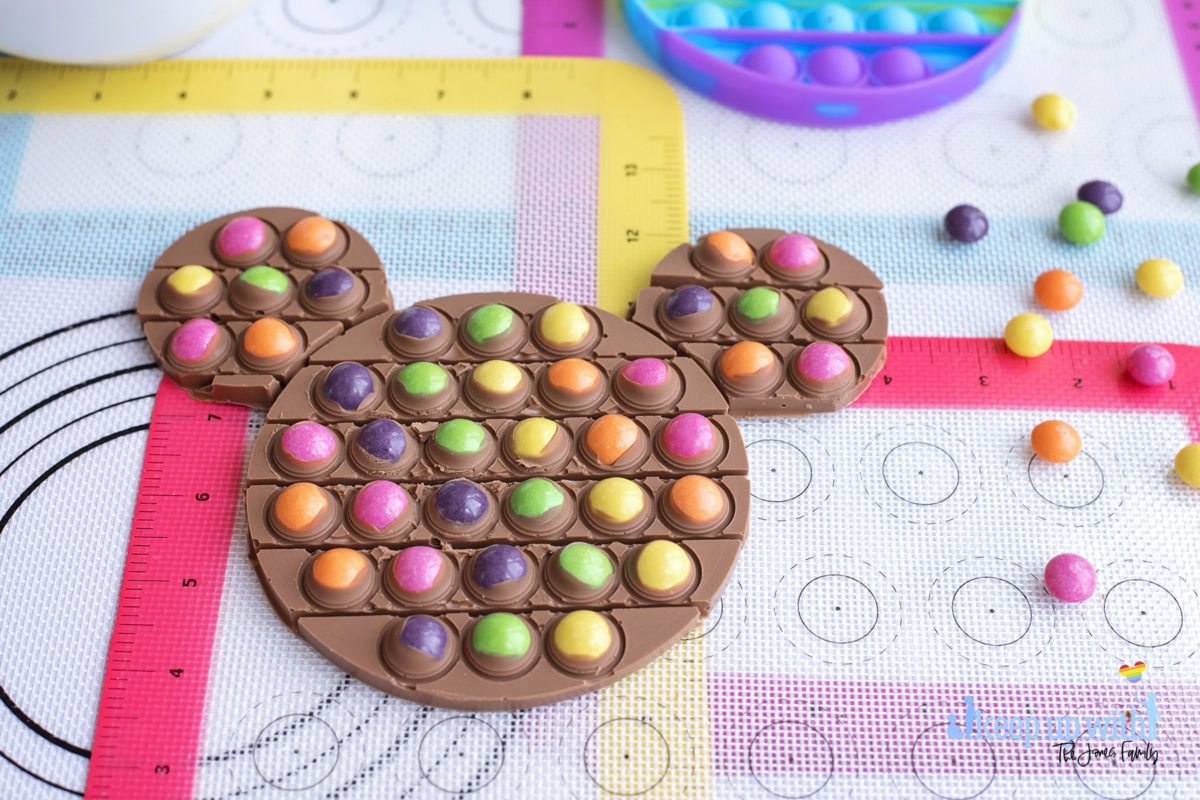 Image shows a mickey mouse chocolate pop-it bar filled with dairy milk and skittles candy sweets. Image by keep up with the jones family.