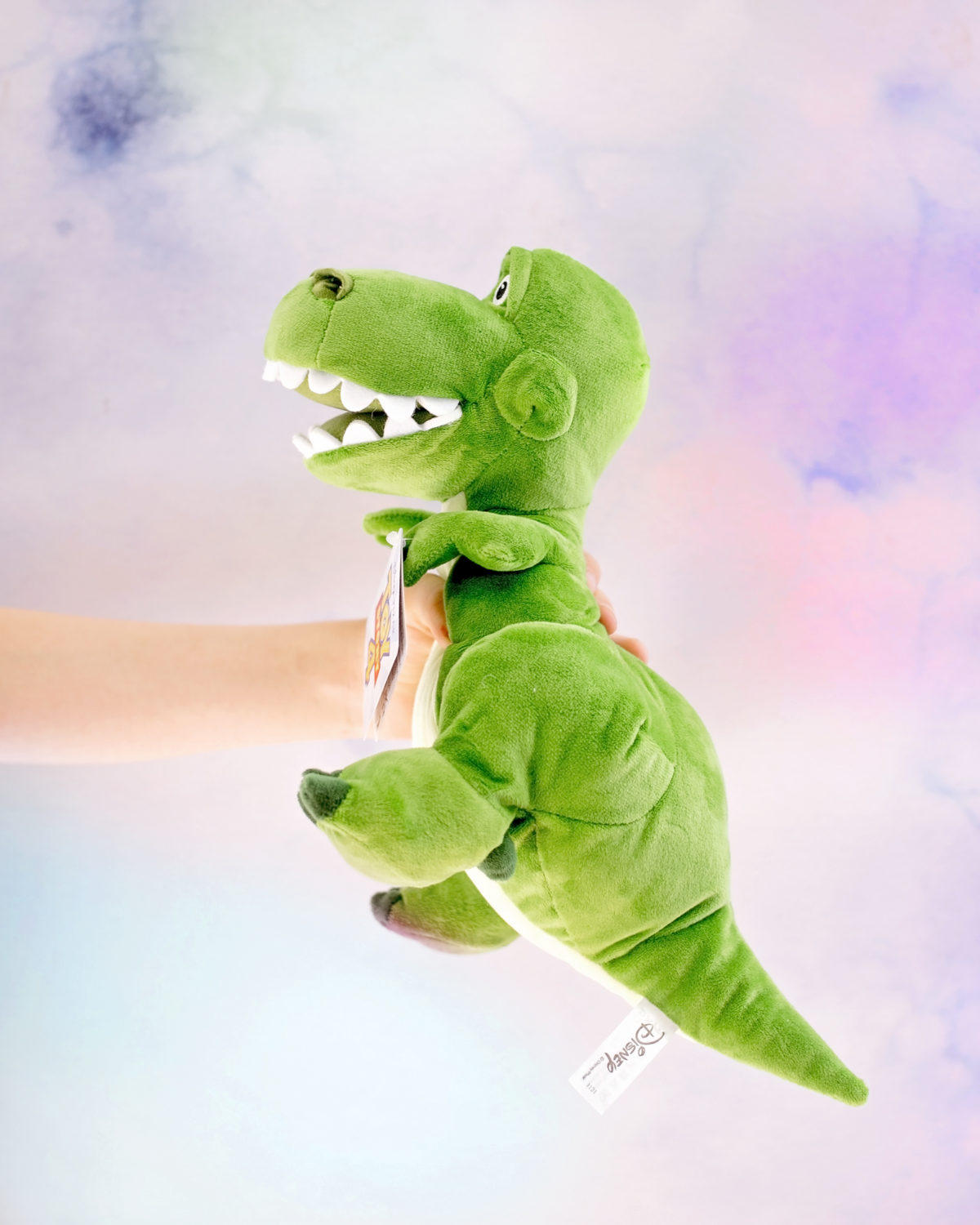 Image shows profile view of Disney Pixar's Toy Story Dinosaur, Rex as a plush toy from SImba Toys. Image by Keep Up With The Jones Family.