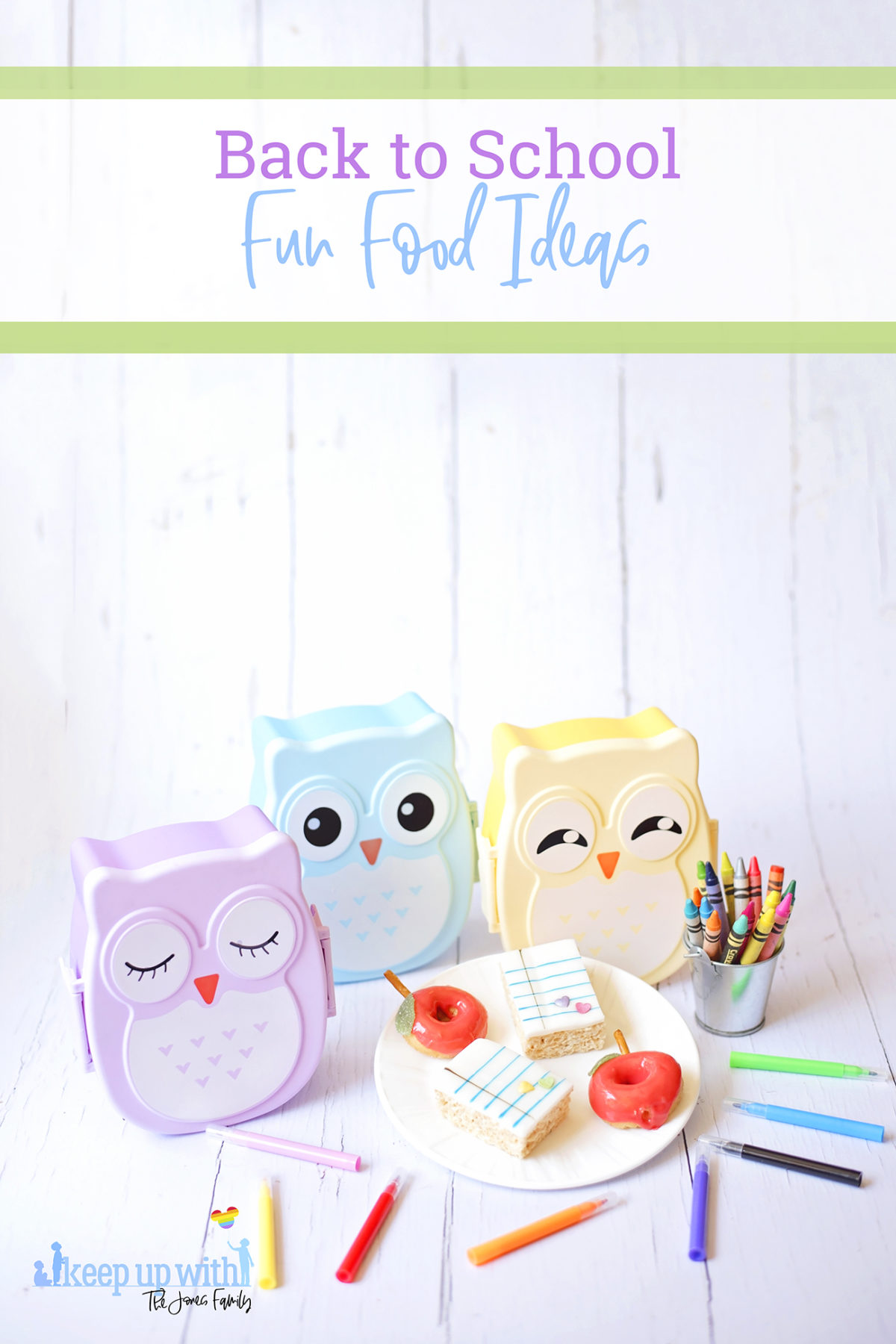 Image shows Back to School Rice Krispie treats and back to school apple shaped doughnuts on a white Vera Wang for Wedgwood plate. There are three pastel coloured owl bento boxes in the background and a small tin bucket of Crayola crayons alongside it. Cake pens surround the plate on the white wooden background. Image by Sara-Jayne from Keep Up With The Jones Family.