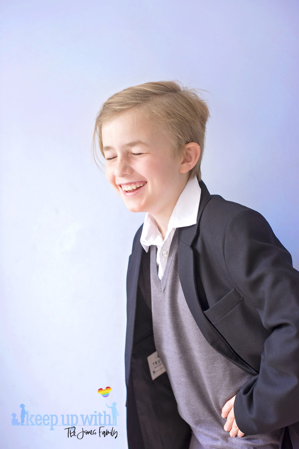 Image shows a boy wearing Trutex School Uniform. Black blazer, grey v-neck pullover and white shirt. Image by Sara-Jayne for Keep Up With The Jones Family
