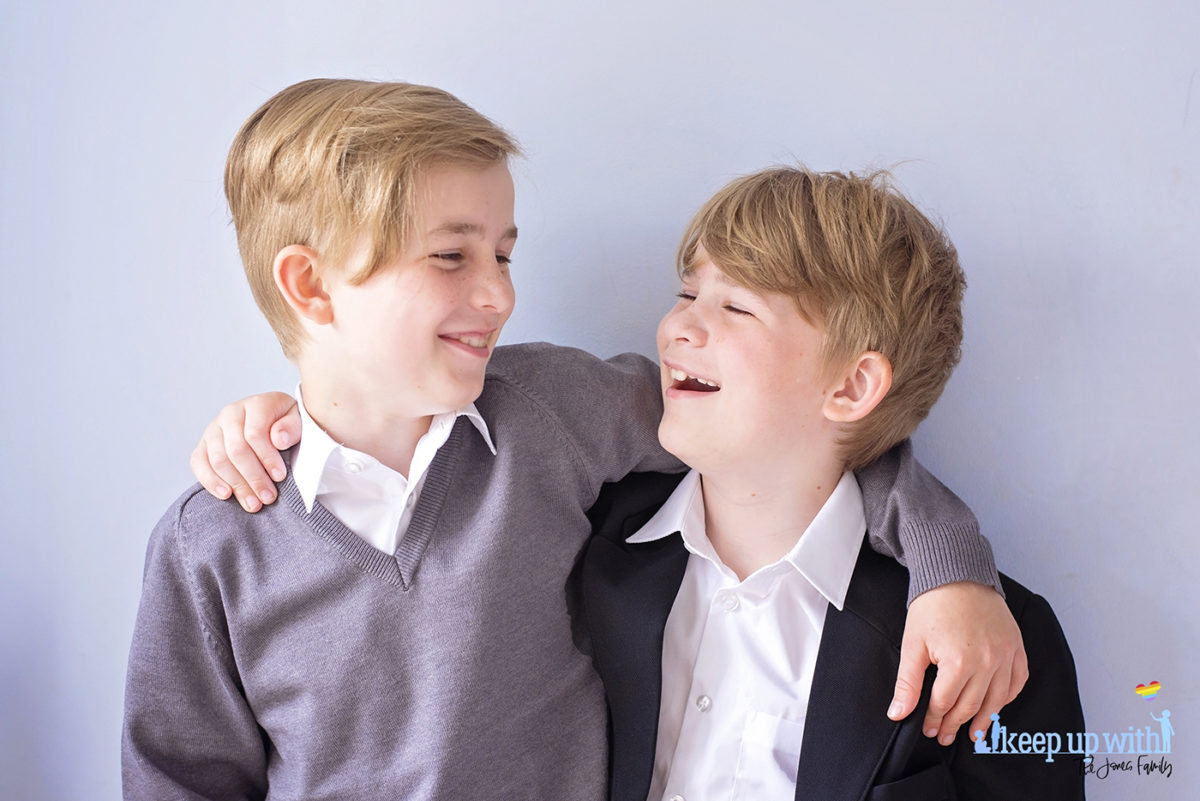 Image shows two boys wearing Trutex School Uniform. Black blazer, grey v-neck pullover and white shirt. Image by Sara-Jayne for Keep Up With The Jones Family